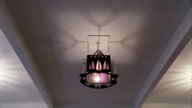 an intricate light fixture hangs in the glasgow school of art. available in hd. - charles rennie mackintosh stock videos and b-roll footage