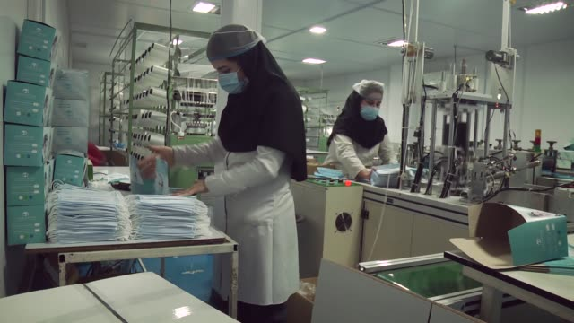 an iranian company in the capital tehran is working full time and at full capacity to produce medical equipment mainly face masks because of the... - iran stock videos & royalty-free footage