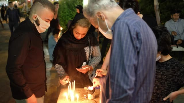an iranian family light candle while attending a ceremony to commemorate ashura in northern tehran on august 30 amid the new coronavirus disease... - ashura muharram stock videos & royalty-free footage