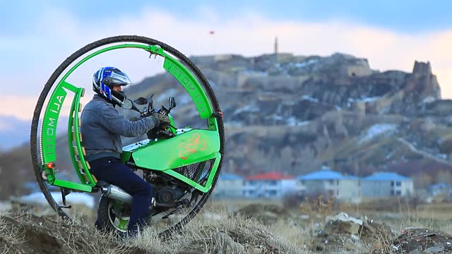an iranian sculptor living in turkey designed a motorcycle with a single-wheel with materials gathered from a scrap metal dealer. inspired by a... - imagination stock videos & royalty-free footage