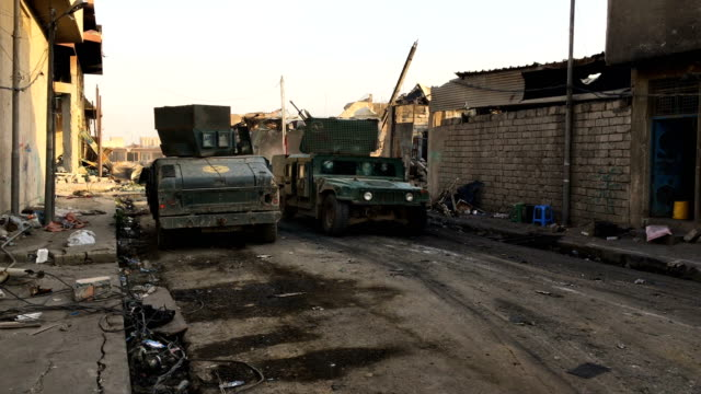 An Iraq forces Humvee drives along a road in West Mosul Iraqi forces backed by US and British air support have entered their sixth month of fighting...