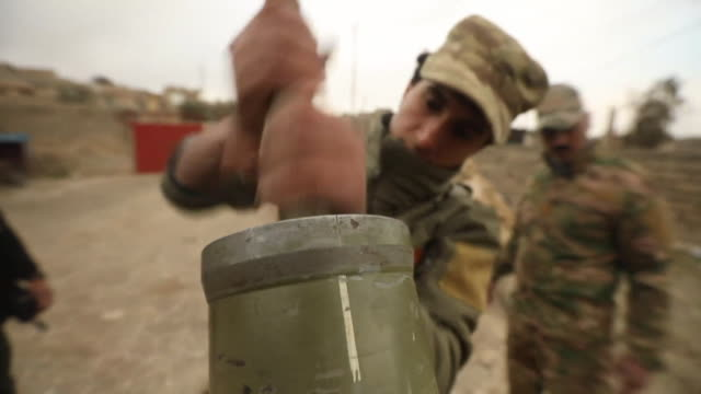 an iraqi army mortar team going through final weapon checks before going to battle with islamic state in western mosul - mortar weapon stock videos & royalty-free footage