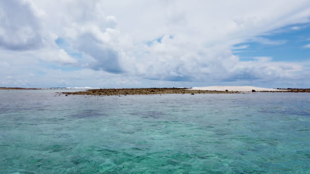 an islet is viewed in the funafuti atoll on november 26, 2019 in funafuti, tuvalu. the low-lying south pacific island nation of tuvalu holds about... - pacific islands stock videos & royalty-free footage