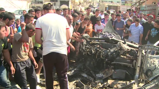 vídeos de stock e filmes b-roll de an israeli air strike targeting a car in the gaza strip killed two palestinians friday medics said hours after a bomb exploded near troops manning... - air raid