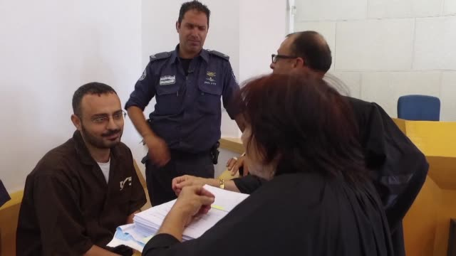 an israeli court on sunday postponed a hearing for a un worker accused of aiding the islamist movement hamas after a dispute over whether he should... - court hearing stock videos and b-roll footage