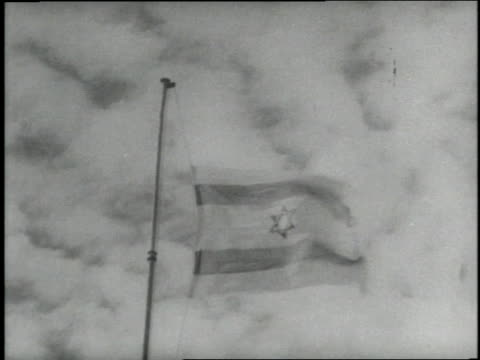 an israeli flag ascends up a flagpole against a cloudy sky - israel stock videos & royalty-free footage