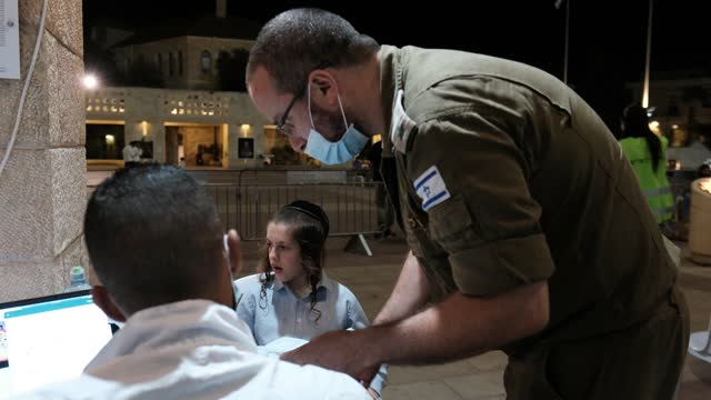 an israeli officer from the home front command unit responsible for civil defense and assisting the population during conflict and crisis registers a... - teenage boys stock videos & royalty-free footage