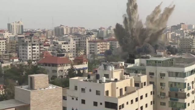 an israeli strike hits a building in gaza as israel's military carried out waves of retaliatory strikes in the gaza strip on sunday after palestinian... - air attack stock videos & royalty-free footage