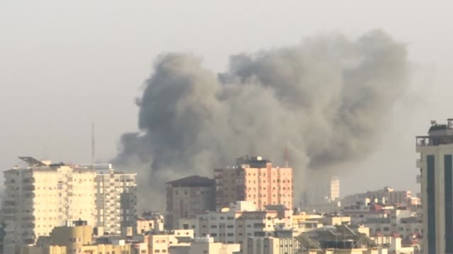 an israeli strike hits a building in gaza as israel's military carried out waves of retaliatory strikes in the gaza strip on sunday after palestinian... - gaza city stock videos & royalty-free footage
