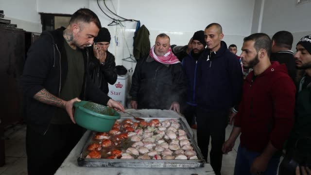 an italian tv chef is serving up a taste of home cooking in the unlikeliest of places: a gaza jail. gabriele rubini, a former rugby player who... - prisoner education stock videos & royalty-free footage