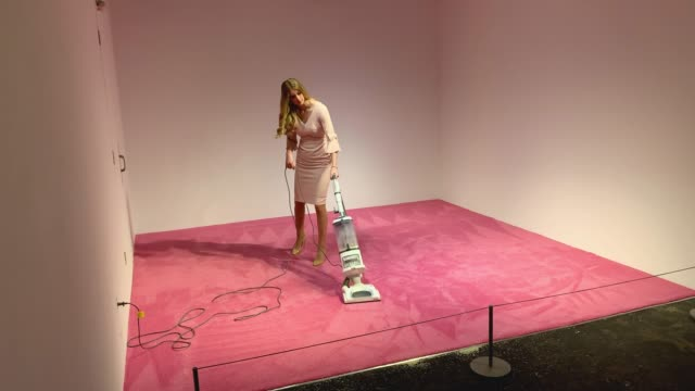 an ivanka trump lookalike model vacuums bread crumbs thrown by visitors as part of an art installation titled ivanka vacuuming at the flashpoint... - installationskunst stock-videos und b-roll-filmmaterial