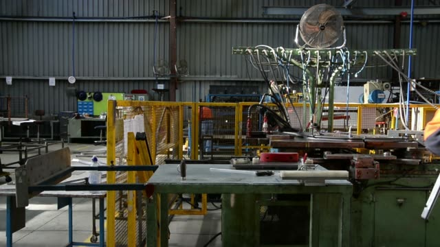 an ixl worker inspects a length of rolled metal in the roll mill at the backwell ixl plant in geelong, australia, on tuesday, may 20 an ixl worker... - length stock videos & royalty-free footage