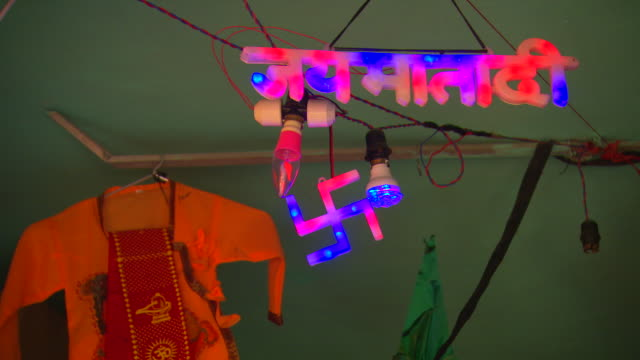 an led swastika flashes on a market stall.  - religion stock videos & royalty-free footage