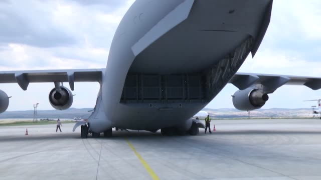 an m1a2 abrams tank is offloaded from a c-17 aircraft in bulgaria as part of operation speed and power. operation speed and power will present the... - operation atlantic resolve stock videos & royalty-free footage