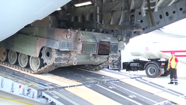 an m1a2 abrams tank is offloaded from a c17 aircraft in bulgaria as part of operation speed and power operation speed and power will present the... - operation atlantic resolve stock videos & royalty-free footage