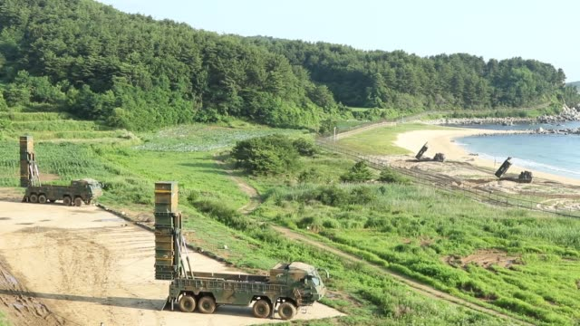 vídeos de stock, filmes e b-roll de an m270 multiple launch rocket system from a battery 6th battalion 37th field artillery regiment 210th field artillery brigade 2nd republic of... - míssil