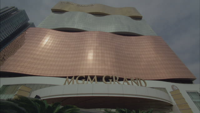 an mgm grand sign advertises the entrance of the casino in macau, china. - macao stock videos & royalty-free footage