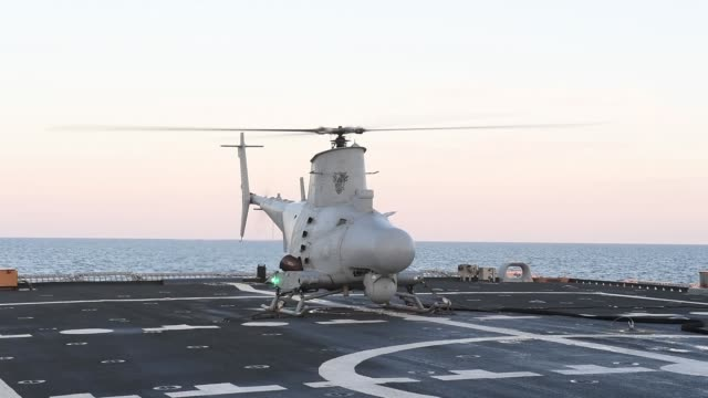 an mq8b fire scout unmanned aerial vehicle assigned to the sea knights of helicopter sea combat squadron 22 conducts flight operations from the deck... - 無人航空機点の映像素材/bロール