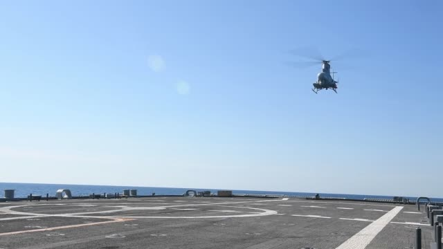 an mq-8b fire scout unmanned aerial vehicle assigned to the sea knights of helicopter sea combat squadron 22 conducts flight operations from the deck... - unmanned aerial vehicle stock videos & royalty-free footage