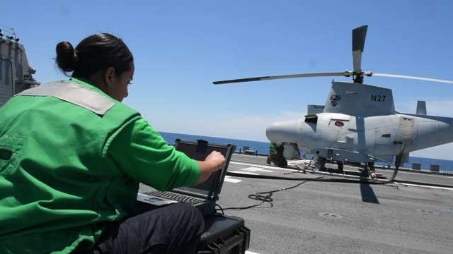an mq8b fire scout unmanned aerial vehicle assigned to the sea knights of helicopter sea combat squadron 22 conducts flight operations from the deck... - litoral stock videos & royalty-free footage