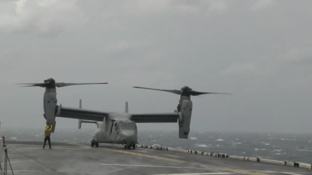 an mv22 osprey tiltrotor aircraft and uh1y huey helicopter assigned to marine medium tiltrotor squadron 265 as well as an mh60s sea hawk helicopter... - osprey stock videos & royalty-free footage