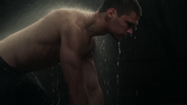 an naked man kneels in rain. - naked stock videos & royalty-free footage