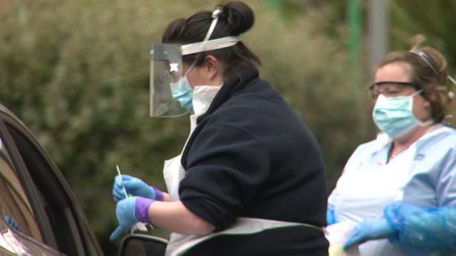 an nhs staff member being tested for coronavirus at a temporary drivein centre - occupation stock videos & royalty-free footage