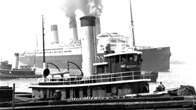 an ocean liner approaches a pier in new york harbor where tugboats dock. - pier stock videos & royalty-free footage