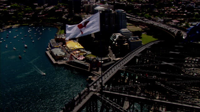 an oceanside swimming pool and the sydney harbour bridge are seen from the air. - sydney stock videos & royalty-free footage