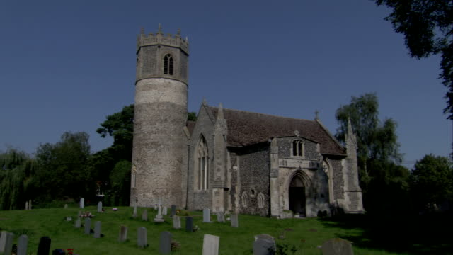 an octagonal belfry tops the round tower of st. mary's church in rickinghall inferior. available in hd. - octagon stock videos & royalty-free footage