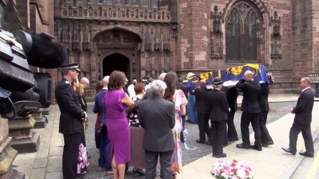 an offduty police officer killed in the manchester bombing was given a guard of honour by colleagues at her funeral family friends and colleagues of... - chester cheshire stock-videos und b-roll-filmmaterial