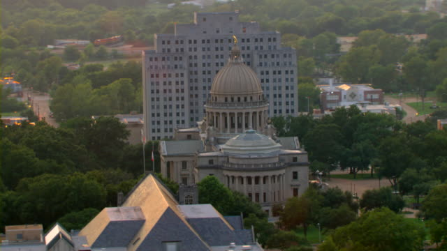 an office building overlooks the capitol building in jackson, mississippi. - jackson stock videos & royalty-free footage