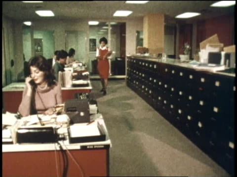 an office worker distributes interoffice mail - 1970 stock videos & royalty-free footage
