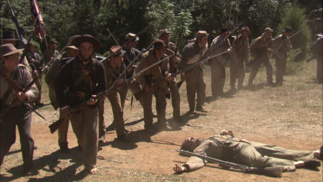 an officer leads confederate soldiers into battle in a civil war reenactment. - reenactment stock videos & royalty-free footage