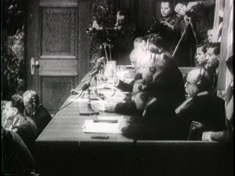 an official calls the name of one of the accused nazi criminals at the nuremberg trials following world war ii - crime or recreational drug or prison or legal trial stock-videos und b-roll-filmmaterial