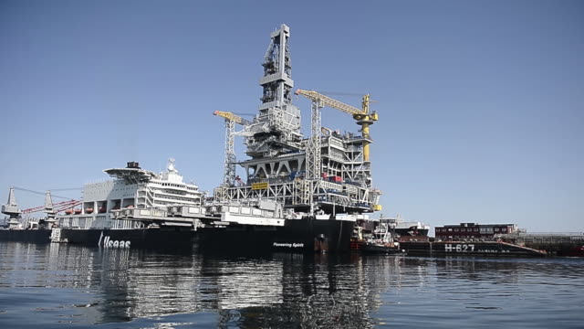 an oil drilling platform sits on board the world's largest construction vessel, the pioneering spirit, in the bomla fjord near leirvik, ahead of its... - fossil fuel stock videos & royalty-free footage
