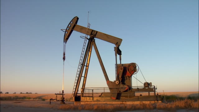 An oil pump pumps in a North Dakota field.
