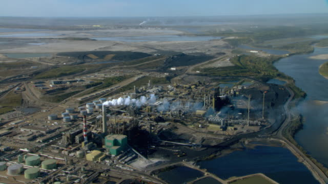 an oil refinery occupies the athabasca oil and tar sands in fort mcmurray, alberta, canada. - alberta stock videos & royalty-free footage