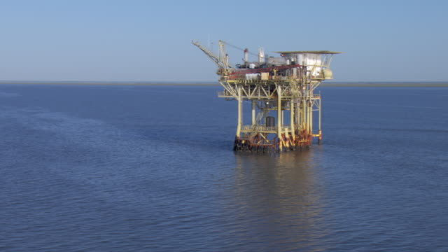 An oil rig lies in Galveston Bay.