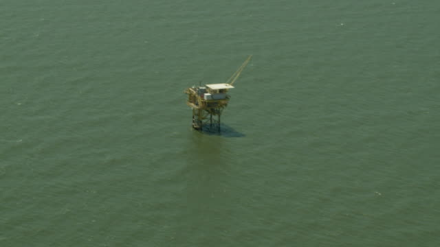 an oil rig operates in the gulf of mexico. - gulf of mexico stock videos & royalty-free footage
