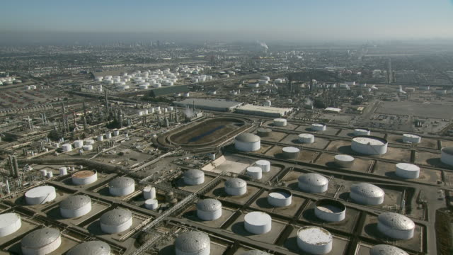 an oil terminal with storage tanks containing oil or petrochemicals at carson, california. - fuel storage tank stock videos and b-roll footage