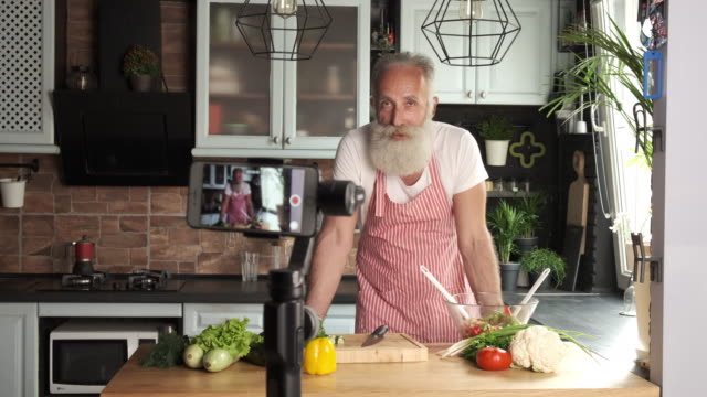 an old bearded man has a culinary blog. one person - facial hair stock videos & royalty-free footage