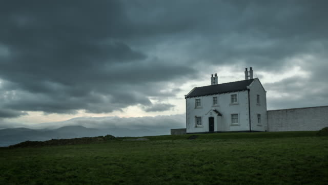 an old coastguard houses on black point in anglesey - remote location stock videos & royalty-free footage