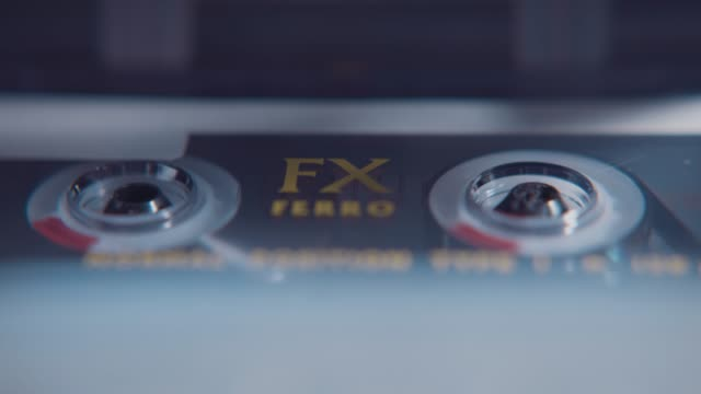an old fx ferro audio cassette tape playing in a tape deck. - retro style stock videos & royalty-free footage