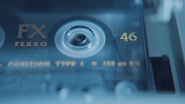 an old fx ferro audio cassette tape rewinding in a tape deck - stereo personale video stock e b–roll