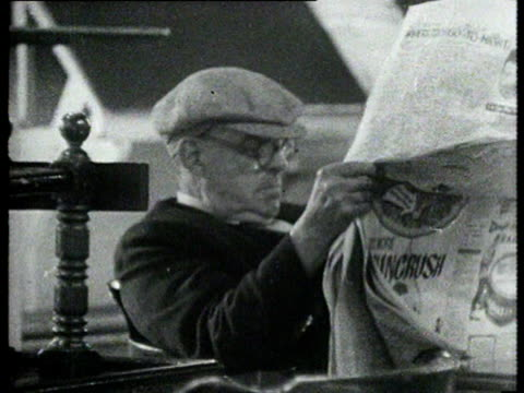 an old man in a flat cap reads a newspaper - flat cap stock videos & royalty-free footage
