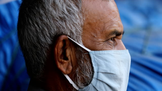 an old man sits in front of a market during governmentimposed lockdown as a preventive measure against the covid19 coronavirus in dhaka bangladesh on... - senior men stock videos & royalty-free footage