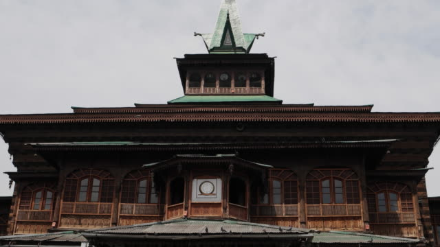 an old medieval mosque, intricatly detailed,  in the old city of srinagar - jammu e kashmir video stock e b–roll