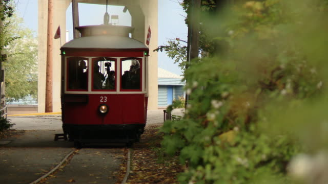 An old red tram on rails