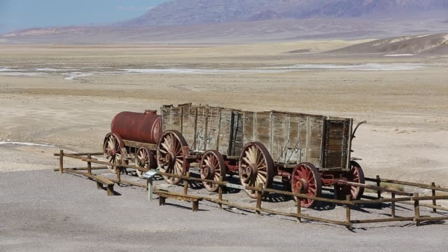 an old wagon train at the harmony borax works in death valley which is the lowest hottest driest place in the usa with an average annual rainfall of... - mineral stock-videos und b-roll-filmmaterial
